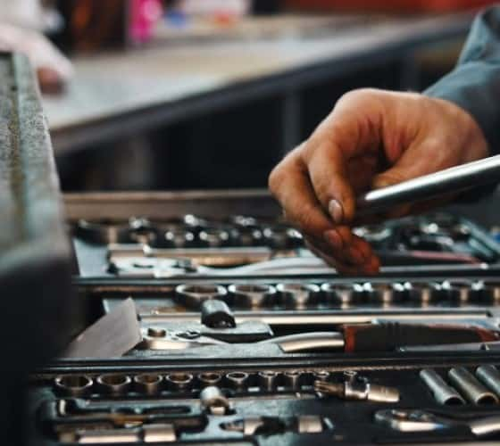 stock-photo-a-set-of-tools-for-repair-in-car-service-mechanic-s-hands-close-up-567460636